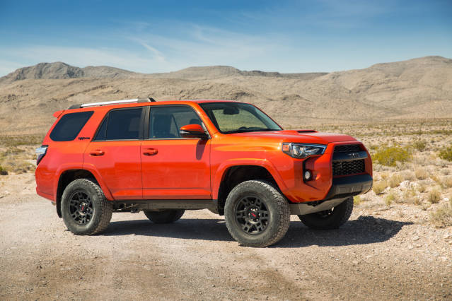 2015 Toyota 4runner vs. 2015 Jeep Grand Cherokee side 4runner